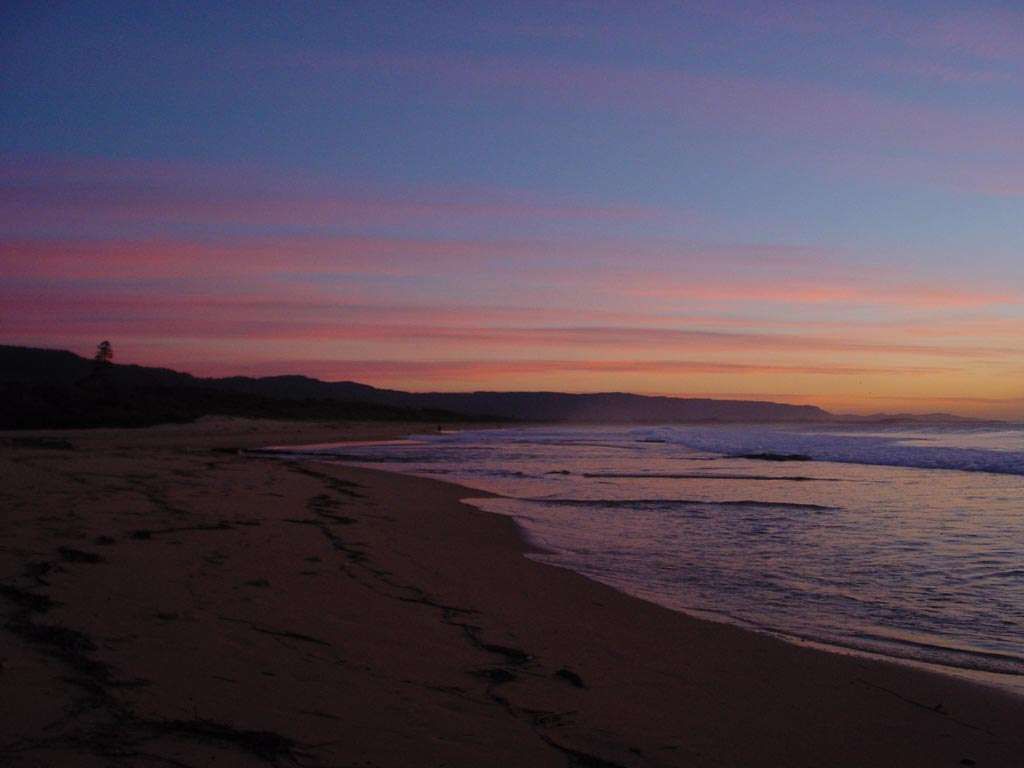 sunrise over the pacific at north wollongong beach. Black Bedroom Furniture Sets. Home Design Ideas