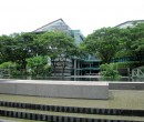 Singapore Management University and water feature above Bras Basah MRT
