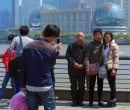 People explore the The Bund, Shanghai, China.