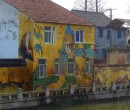 Mural on homes by a canal in SongJiang, China.