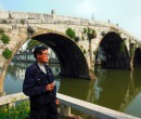 Photographer by elegant arch bridge in SongJiang, Shanghai, China.